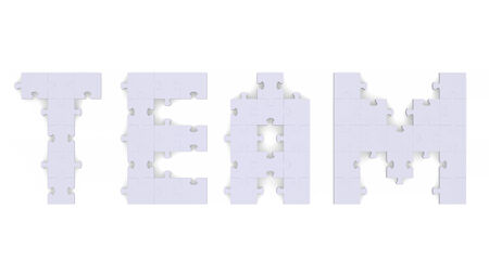 assembled: 3d team text assembled of grey puzzle pieces