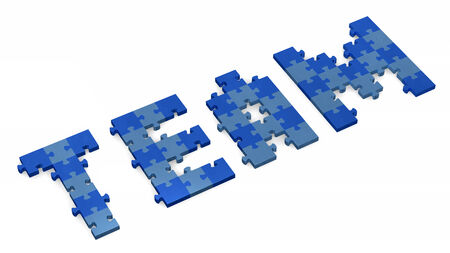 assembled: 3d team text assembled of blue puzzle pieces, perspective view