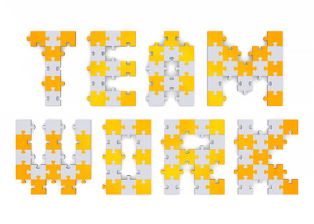 3d teamwork text assembled of golden and grey puzzle pieces photo
