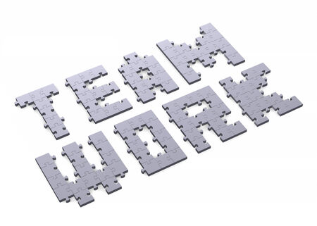 assembled: 3d teamwork text assembled of grey puzzle pieces, perspective view Stock Photo