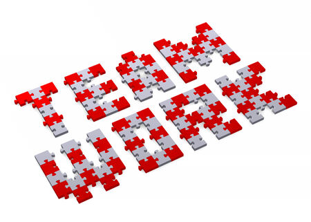 assembled: 3d teamwork text assembled of red and grey puzzle pieces, perspective view