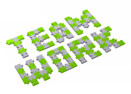 assembled: 3d teamwork text assembled of green and grey puzzle pieces, perspective view