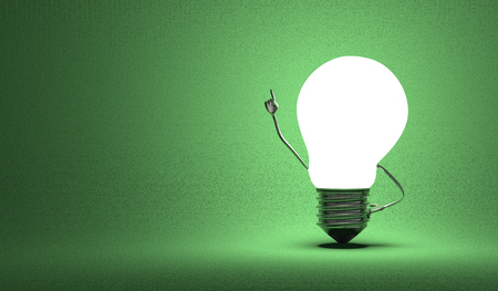 Glowing light bulb character in moment of insight on dark green textured background Standard-Bild
