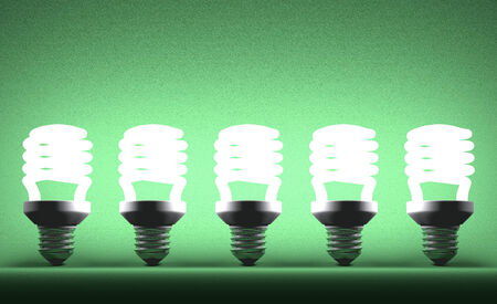 Row of glowing fluorescent light bulbs on green textured background photo