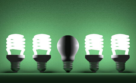 failed attempt: Switched off tungsten light bulb among glowing fluorescent ones on green textured background Stock Photo