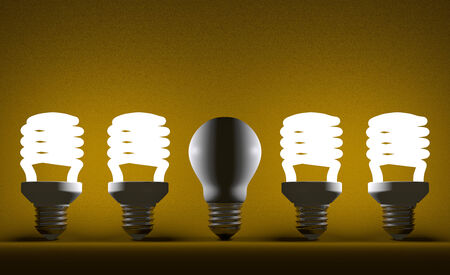 Switched off tungsten light bulb among glowing fluorescent ones on yellow textured background photo
