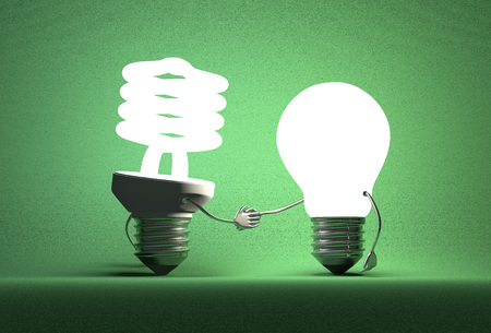 Glowing spiral light bulb character and tungsten one handshaking on dark green textured background Imagens