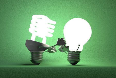 tungsten: Glowing fluorescent light bulb punching tungsten one with its fists on green textured background