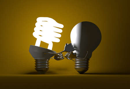 tungsten: Glowing fluorescent light bulb punching switched off tungsten one with its fists on yellow textured background Stock Photo