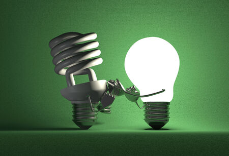 incandescent: Glowing tungsten light bulb punching switched off spiral one with its fists on green textured background Stock Photo