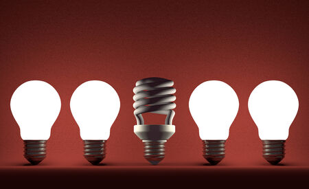 Switched off fluorescent light bulb in row of glowing incandescent ones on red textured background photo