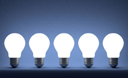 ineffective: Row of glowing tungsten light bulbs on blue textured background Stock Photo