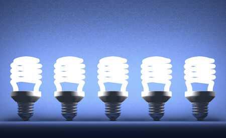 Row of glowing fluorescent light bulbs on blue textured background photo