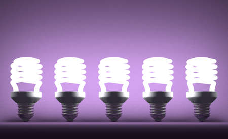 Row of glowing fluorescent light bulbs on violet textured background photo