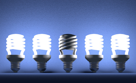 Switched off fluorescent light bulb in row of glowing ones on blue textured background photo