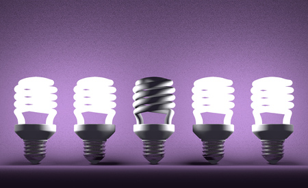Switched off fluorescent light bulb in row of glowing ones on violet textured background photo