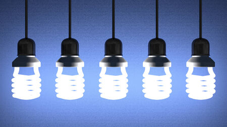 creative power: Glowing fluorescent light bulbs installed in sockets hanging on wires on blue textured background
