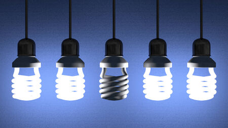 Switched off fluorescent light bulb hanging among glowing ones on blue textured background photo