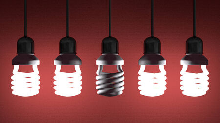 Switched off fluorescent light bulb hanging among glowing ones on red textured background photo