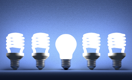 Glowing tungsten light bulb in row of fluorescent ones on blue textured background photo