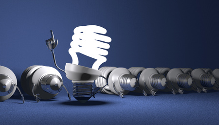 Glowing fluorescent light bulb character in moment of insight standing among many switched off lying ones on blue textured background photo