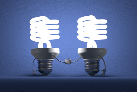 energetics: Glowing spiral light bulb characters handshaking on blue textured background