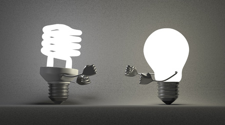 incandescent: Glowing fluorescent light bulb and tungsten one fighting with their fists on gray textured background