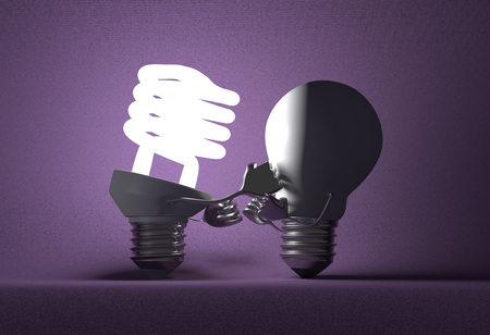 tungsten: Glowing fluorescent light bulb punching switched off tungsten one with its fists on violet textured background