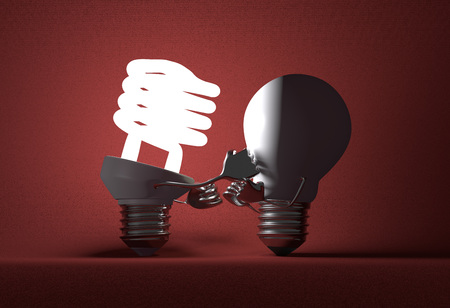 tungsten: Glowing fluorescent light bulb punching switched off tungsten one with its fists on red textured background
