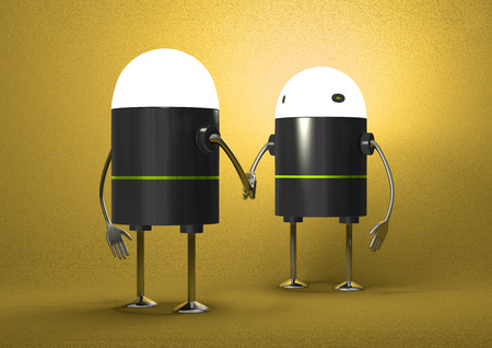 Robots with glowing heads handshaking on yellow textured background, front view photo