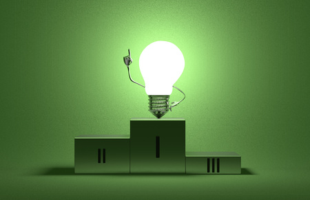 Glowing tungsten light bulb character on podium in moment of insight on green textured background photo
