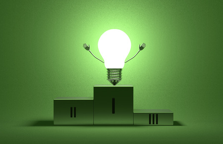 Glowing triumphant tungsten light bulb character on podium on green textured background Stock Photo