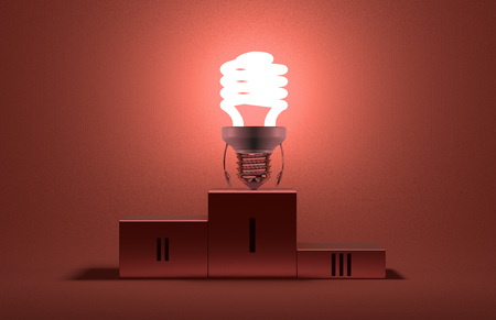Glowing fluorescent tungsten light bulb character on podium on red textured background photo