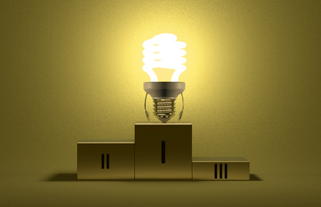 Glowing fluorescent tungsten light bulb character on podium on yellow textured background photo