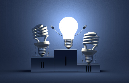 Glowing tungsten light bulb character and switched off fluorescent ones on podium on blue textured background photo