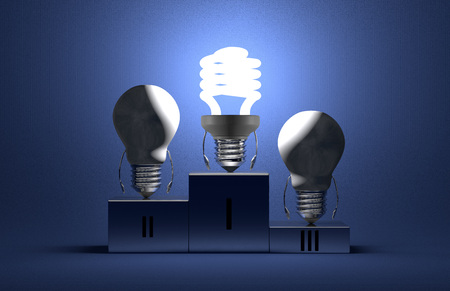 Glowing fluorescent light bulb character and switched off tungsten ones on podium on blue textured background photo