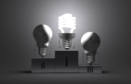 Glowing fluorescent light bulb character and switched off tungsten ones on podium on gray textured background photo