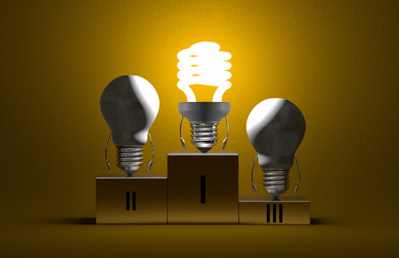 Glowing fluorescent light bulb character and switched off tungsten ones on podium on yellow textured background photo