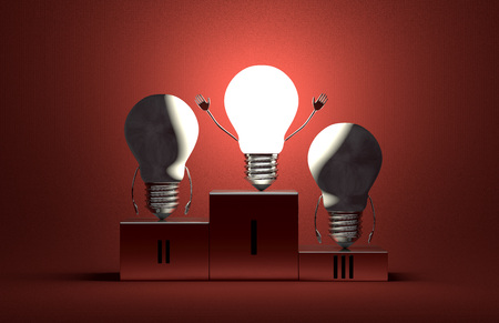 Triumphant glowing tungsten light bulb character and two switched off ones on podium on red textured background photo