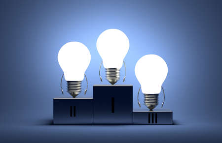Glowing tungsten light bulb characters on podium on blue textured background photo
