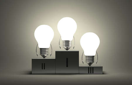 Glowing tungsten light bulb characters on podium on gray textured background photo