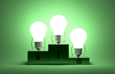 Glowing tungsten light bulb characters on podium on green textured background photo