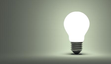 gray bulb: Shining arbitrary light bulb on gray background Stock Photo