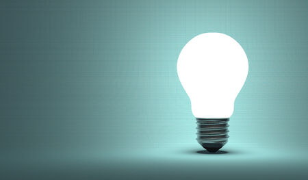 aha: Shining arbitrary light bulb on pale blue squared background