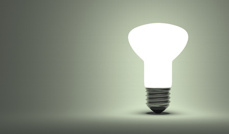 krypton: Shining ellipsoidal light bulb on gray background Stock Photo