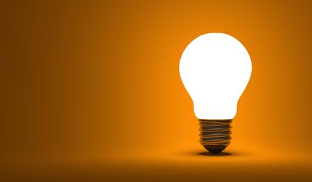 arbitrario: Luminoso bombilla arbitraria sobre fondo naranja