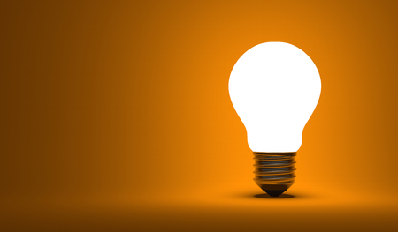 aha: Shining arbitrary light bulb on orange background Stock Photo