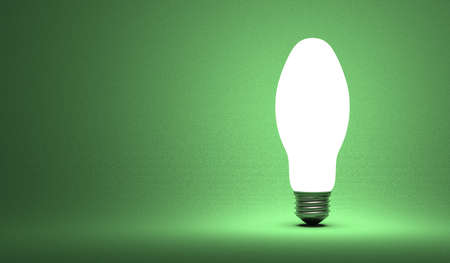 aha: Shining ellipsoidal light bulb on green background