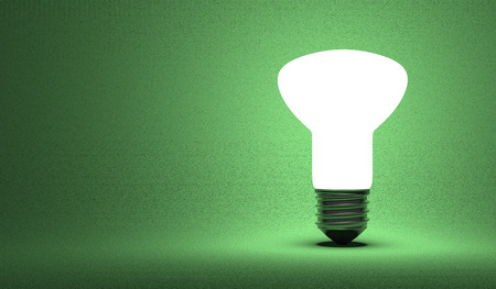 krypton: Shining ellipsoidal light bulb on green background