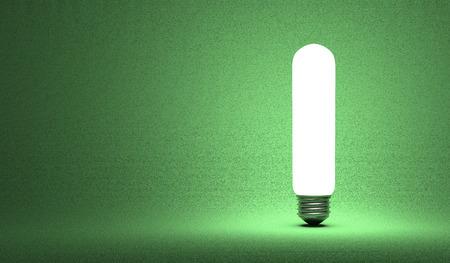 tubular: Shining tubular light bulb on green background